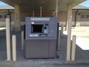 Picture of an ATM installed in a bank drive thru in Frisco TX